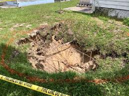 a sinkhole that opened in moon lake monday has forced the evacuation of four pasco county mobile homes
