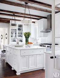 White kitchen pendant lighting Farmhouse Kitchen Oak Beams Shelter This Kitchen Which Has Viking Hood And Cooktop And Calacatta Gold Marble Counters The Alabaster Pendant Lights Are By Urban Architectural Digest 31 Kitchens With Pretty Pendant Lighting Architectural Digest