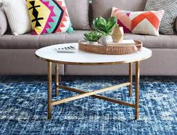 Decorate your coffee table with style. Ideas For How To Style A Round Coffee Table Apartment Therapy
