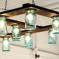 how to make a mason jar wagon wheel chandelier mason jar chandelier how to make a mason jar chandelier mason jar light fixture best mason mason jar