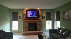 hide cable box behind tv above fireplace where to put cable box large of inspirational hiding