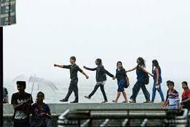 photo essay rain diaries slideshow livemint teenagers enjoying the rains at the seafront on marine drive mumbai photo rajanish