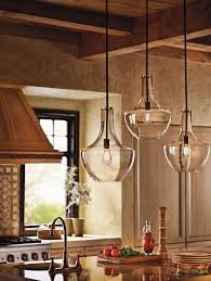 glamorous kichler lighting in kitchen farmhouse with clear glass pendants next to edison light fixture alongside single bulb