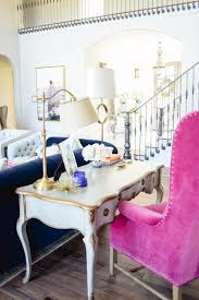 feature a writing desk as a sofa table to maximize e and function while maintaining a decorative look