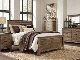 modern queen bedroom sets. trinell queen bedroom set - replicated oak grain takes the look of rustic reclaimed wood on this panel bed. modern farmhouse style is at home in sets
