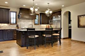 paint colors that look good with dark kitchen cabinets. this kitchen uses a spectrum of lighter shade cream, brown, and beige to paint colors that look good with dark cabinets