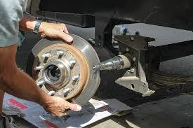 begin the installation process by removing all parts from the existing trailer axles for reuse on