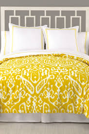 image of trina turk ikat queen duvet yellow white