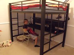 black metal full size loft bed with long desk underneath and two black metal full size loft bed with long desk underneath and two straight ladder on