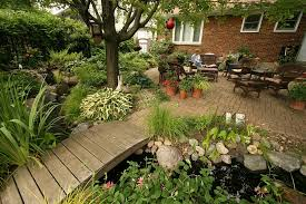 view in gallery small urban garden landscape with outdoor living bridge and a water garden design