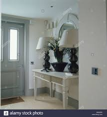 Console Table Lights Tall Black Glass Lamps With White Shades On Cream Console