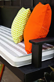 outdoor affordable geometric indoor and outdoor seat cushion in green and white weather resisitan available
