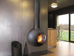 interior round grey mantel electric fireplace on grey wall connected by brown floor amazing