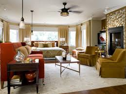 gold master bedroom with pendant lighting