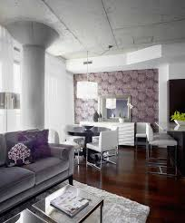 chrysanthemum wallpaper is a purple living room idea that adds an abstract beauty to a space that is otherwise adorned with silver and white