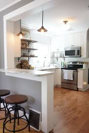 White shaker cabinets, marble countertops, white subway tile, and