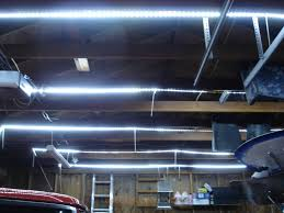 garage with cool white flexible led strips installed across beams