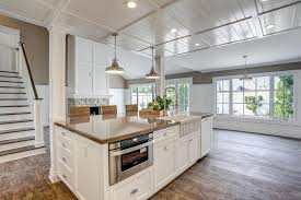 kitchen island with a sink and microwave