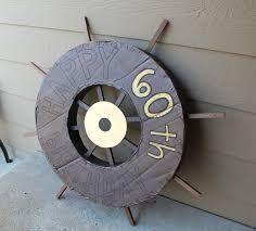 cardboard ship wheel and fake portholes
