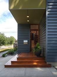 corrugated metal siding exterior contemporary with orange mailboxes