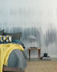 colorhouse diy watercolor wall drip technique in a blue bedroom