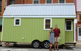tiny house news. Kylie Osterhus And Aaron Gamm Stand In Front Of Their Tiny House [Courtesy/Fillmore News