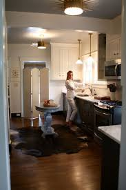 i never would have considered the cowhide a kitchen approved rug but i m really digging this image credit farmer s trophy wife