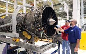 tinker jet engine mechanic bill gras in hat with the 544th propulsion maintenance squadron and pratt whitney f135 quality inspector matt fisher turbine engine mechanic