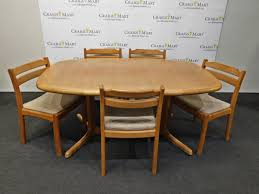 teak dining table and chairs by dyrlund of