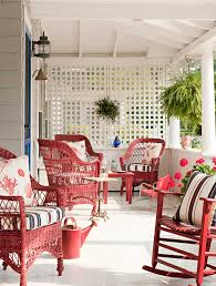 red wicker patio set nestled in stark white