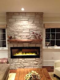 electric fireplace with natural stone barn beam mantel traditional living room
