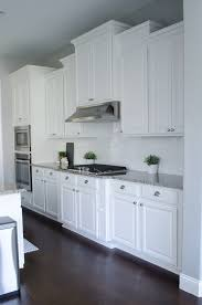 White Kitchens Dark Floors Kitchen Kitchen With White Cabinets And Wide Hardwood Plank