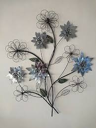 silver flowers on a branch metal wall