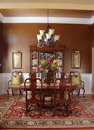 appealing ethnic dining room rug for dining room table with flower under branched lamp