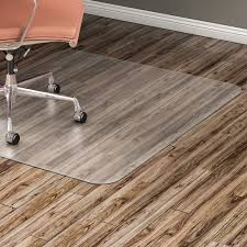 chairmat features a nonstudded design made specifically for hard floor surfaces sy 1 16 thick material protects wood tile and vinyl flooring from
