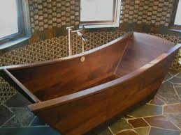 wooden bathtubs can hardly be described as simple bathtubs regardless of their shape size or color they are anything but mundane as their pattern brings
