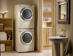 laundry furniture. Organizing Small Laundry Room Spaces With Stacked Washer Dryer In The Corner Plus Wooden Rack For Towel Storage And Rattan Basket Ideas Furniture