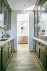 bathroom hall with glass front built in linen cabinets