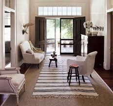 summer rugs black and white striped dhurrie rug over sisal in a hallway house