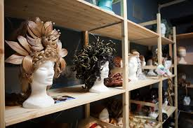 the route to follow in wig making starts with measurements we physically take the measurements of the actor s head and there is a shelf with the models