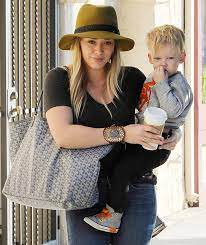 A story that catapults us back. Hilary Duff Uses Goyard As A Baby Bag Purseblog