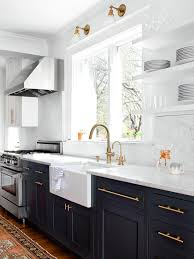 bright airy kitchen with warm metallic hardware