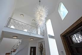 add depth to your house with chandeliers foyer white walls and contemporary chandelier