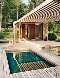tiny plunge pool with a wooden deck