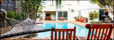 bloubergstrand acmodation secret garden guesthouse in cape town offers four star luxury acmodation in bloubergstrand cape town