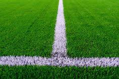 white line on green grass of a soccer field selective focus37 green