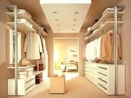 walk through master closet to bathroom behind bed bedroom design wal