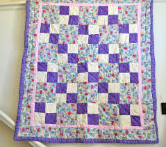 Quilting for Charity: Projects & Quilting Charities & Quilt Featuring Purple, White and Patterned Blocks Adamdwight.com