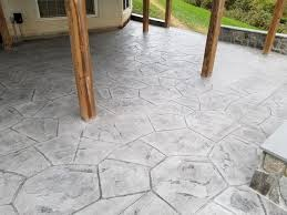 c stamped concrete patio with a wall