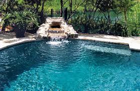 ... Swimming pool with small rock waterfall ...